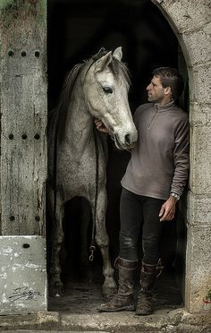 Refreshing to see a photo of a Beautiful horse with a man, =)    you always see girls n women with horses