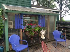 The farm greenhouse out by the firepit patio ---