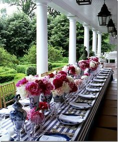 Dahlias and  blue and white porcelain with linen napkins for outdoor luncheon