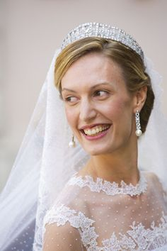 """Ms. Elisabetta """"Lili"""" Rosboch von Wollenstein wearing the Queen Elisabeth diamond bandeau tiara from the Belgian royal family for her wedding to Prince Amedeo of Belgium in Rome's Basilica Santa Maria in Trastevere on July 5, 2014"""