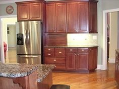 Benjamin Moore Saybrook Sage - almost exactly the colors I settled on for my last kitchen.  Love the sage with dark cherry cabinets.