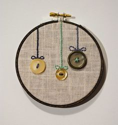 button hoop. AWESOME idea to display some of my extra special buttons ♥