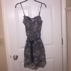 Beautiful Teared Sundress Beautiful floral/minimal gray scale sun dress with a black tie belt. Rayon/ sheer material with a slip. Size 6 but is very stretchy and could fit size 8/10 American Eagle Outfitters Dresses Midi