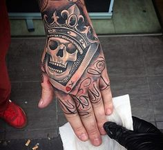 Enthralling Man With Smiling Skull And Crown Tattoo On Hands Lucky Charm, New Men Tattoos January 2017
