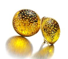 A Pair of Carved Amber and Gold Ear Clips, by JAR. Available Exclusively at FD Gallery. www.fd-inspired.com