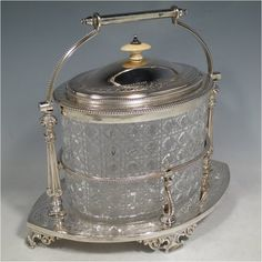 An Antique Victorian silver plated and cut crystal biscuit jar. Biscuits, Tea Art, Hand Engraving, Candy Dishes, Cookie Jars, Cut Glass, Antique Silver, Silver Plate, Barrel
