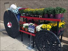 A second interpretation of Tractor outfitted with circular plastic Dunnage Racks upended as Wheels. A circular stack of Dunnage Racks might be efficient merchandising, but upending like this is muc… Mums For Sale, Tractor Pulling, Visual Merchandising, Tractors, Walmart, Wheels, Retail, Plastic, Display