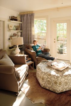 Love the ottoman ~ from Southern Living -- Real-Life Redo: Cozy Den.Decorating Editor Anne Turner Carroll shares the decorating tricks and tips she used in her own small space makeover {slide show} Living Room Redo, Living Area, Living Rooms, Southern Living, Den Room, Room Art, Small Sitting Rooms, Sitting Room Decor, Cozy Den