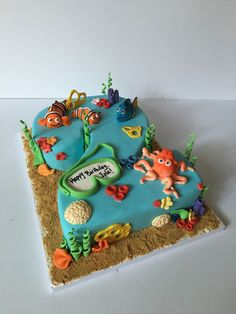 """Finding Nemo/ Finding Dory combo cake for a 2-year old birthday party. This birthday girl loves both movies, so we tried to combine both with a number she knew and recognized - her birthday """"2""""!"""