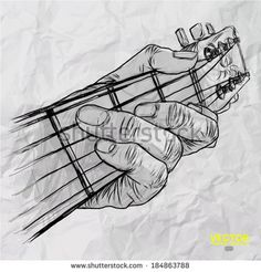 hand drawn of had playing guitar on crumpled paper background  by everything possible, via Shutterstock