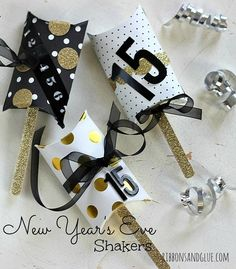 DIY New Year's Eve Noise Maker Shakers made from a pillow box with popcorn kernels inside.  Love the gold glitter tape!