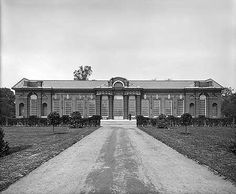 Exterior elevation of the Orangery at Kensington Palace. The Orangery, to the north of Kensington Palace, was built for Queen Anne between 1704-5. The Bedford Lemere daybook records that the photograph was taken for 'J C S'.