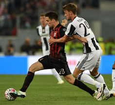 Giacomo Bonaventura of AC Milan and Daniele Rugani of Juventus FC in action during the TIM Cup match between AC Milan and Juventus FC at Stadio Olimpico on May 21, 2016 in Rome, Italy.