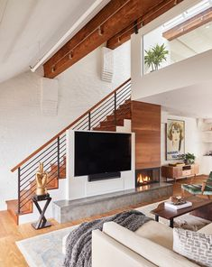 Original wood beams anchor this North End condo designed by Head to the link in bio to see more of the home, which features water views and tons of unexpected details. Home Stairs Design, Interior Stairs, Home Interior Design, Staircase Design Modern, Living Room Under Stairs, Home Living Room, Living Room Designs, Classic House Design, House Stairs