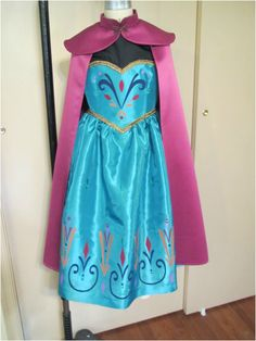 Elsa's Coronation Dress - sewing the cape - could use this cape pattern for Anna, just add the bobble fringe thing.