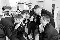 Groomsmen checking out the the groom's wedding ring