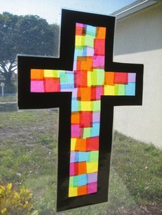2 pieces of contact paper, tissue pieces and construction paper. Let kids cut up tissue paper of their color choice, stick on contact paper, cover. Then cut cross or other shape or JESUS out of construction paper on top.