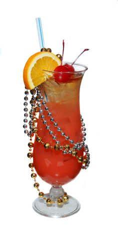 Mardi Gras Hurricane - The delicious concoction is made up of ice, light rum, passion fruit syrup, lemonade spritz and 151 proof rum. The bead accessories poured over the glass definitely give this tasty treat an extra pinch of flavor. Cocktails, Party Drinks, Cocktail Drinks, Fun Drinks, Cocktail Recipes, Alcoholic Drinks, Drink Recipes, Sparkling Drinks, Cocktail Glass