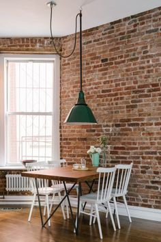The dining nook almost feels like the country with the farmhouse-style chairs and dome pendant.