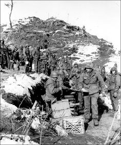 Men of Company A, 1st Bn, 19th Inf Reg , 24th Inf Div receiving New Years Day dinner on the MLR. Korea Jan 1, 1952