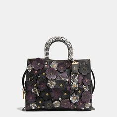 Shop The COACH Rogue With Exotic Tea Rose Applique. Enjoy Complimentary Shipping & Returns! Find Designer Bags, Wallets, Shoes & More At COACH.com!