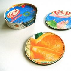 Coasters recycled - juice carton & rubber rings ....