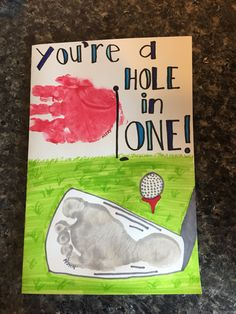 Father's Day card. Hole in one. Golf club footprint, golf flag handprint