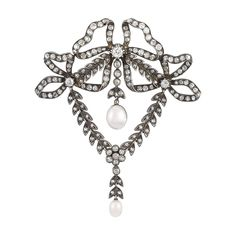 Belle Epoque Silver, Gold, Diamond and Pearl Bow Brooch   Topped by three looped bows completed by a garland swag, set throughout with old-mine cut diamonds, centering one oval button pearl, suspending one pearl, circa 1890