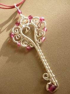 Pink Key pendant -  Fairly certain I could manage something like this myself.