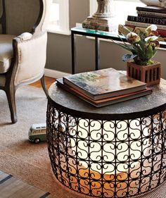 Neat idea--open filigree table with a lamp placed underneath, but inside the table bottom...