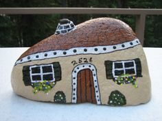 My first attempt at painting a house on a rock