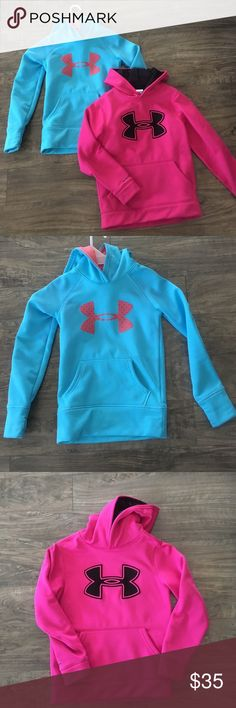 2 girls U.A hoodies Both are xs in great shape little tiny tiny spot in 4th pic probably will come out with a little oxy clean. One is beautiful bluish colt with pink X and inside hood other is a darker pink with black X and inside hoodie. Price is firm I pay full price for my kids clothes. BUNDLE Under Armour Shirts & Tops Sweatshirts & Hoodies