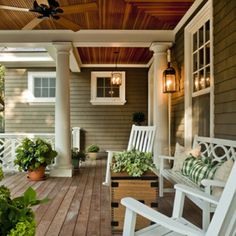 Country porch, rocking chairs and vintage trunk, I love the use of the colors and combination of woods used here....