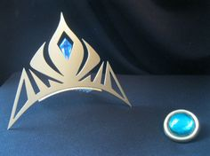 Elsa Crown from FROZEN could easily make this from painted foam and add the hair comb...