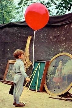 The Red Balloon - not sure if I liked this movie as a child, though I do remember seeing it a few times in class.  - Dee