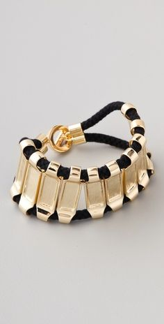 Part of a collaboration with L.A.M.B., this rope bracelet features gold-plated bar details. Ring-and-toggle clasp.