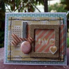 Shell Carman created faux washi tape with 3D Foam Tape and a rubber stamp for this Love Card. See her tutorial on the Crafty Power Blog for Scrapbook Adhesives by 3L. Also uses Prima Flowers, Clearsnap Ink, Crate Paper.