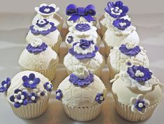 Vanilla cupcakes with fondant toppers and decorations