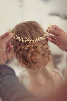 Wedding Hairstyle-Braided bun and golden hair accessories.