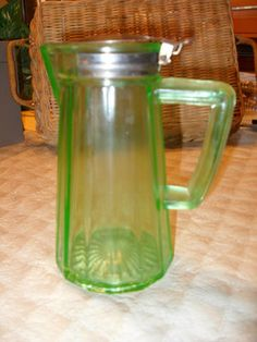 ANTIQUE Vintage Green Uranium Depression Glass Creamer SYRUP PITCHER TIN 1916    | Add to Watch list  Seller information  dtwardell (122  )  100%Positive feedback  Save this seller  See other items     AdChoice  Item condition:--  Time left: 5d 05h (Apr 03, 2013 14:07:40 PDT)  Starting bid:US $7.77  [0 bids ]