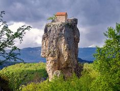 The Katskhi Pillar is a 130 feet high limestone monolith with a church on top built by monks in the 9th or 10th century -- Chiatura, Georgia (Eurasia).