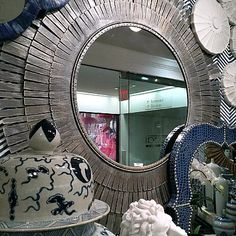 Artistically styled, the round Centurion Wall Mirror from Tozai Home offers an eye-catching wall accessory that fits almost any decor scheme. Each metal frond surrounding the reflective glass can be easily bent to create a variety of edge designs. Hang over a console in the entryway, over the buffet in the dining room, or over the vanity in the powder room!