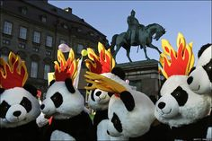 Panda costumes at climate march at 2009 Copenhagen summit to highlight threats of climate change to wildlife.