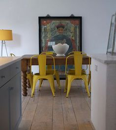 dining room with personality-yellow tolix chairs, mix of styles, the old & new | Flickr - Photo Sharing!