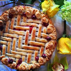 Oh my pie! And roses!  This crust was delicious... #pieart #piepiepie #eatmorepie #pieforbreakfast #herringbone #piecrust #roses #cranberry #cranberrypear #dessert #eggsandhens #flakycrust #piecrust #pretty #ladybaker #baltimore #baltimorepie #sweetandtart #pastry #pastryart #bake