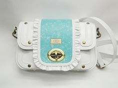 http://www.cityblis.com/item/7891   WHITE AND TURQUOISE LEATHER SHOULDER BAG - $260 by HABJANIC HANDBAGS   Women summer white leather shoulder bag with adjustable strap. Dimension 23 x 15 x 7 cm. Inside is one zipper pocket.