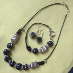Set Acerina bugle, silver beads and black leather cord. Price COP$65.000,=