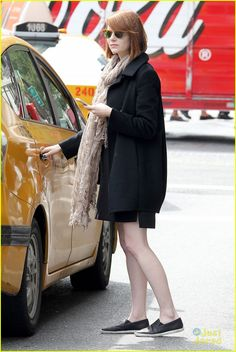 Emma Stone raises her arm to hail a cab on Wednesday afternoon (September 24) in New York City.