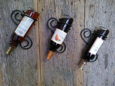 Metal wine rack, wrought iron wine bottle holder, rustic wine bottle hanger, wine bottle display, black wrought iron by metalkraftdecor on Etsy