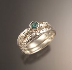 """This pretty wedding set has a nice Victorian antique look. Set with a round natural Colombian Emerald. Set in Sterling silver. The band is wide and thick. The matching band is wide and thick. Specify your size in a """"note to seller"""" at check out. Wedding Sets, Wedding Rings, Bezel Set Ring, Colombian Emeralds, Victorian, Note, Engagement Rings, Band, Sterling Silver"""